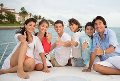 Happy friends with thumbs up Stock Photos