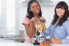 Happy friends about to make healthy juice Stock Photography