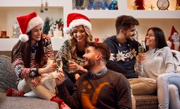 Friends toast with champagne and celebrating Christmas Royalty Free Stock Photo