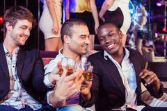 Happy friends toasting with alcohol Royalty Free Stock Image