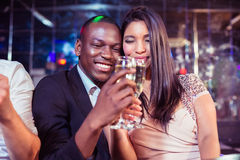 Happy friends toasting with champagne Royalty Free Stock Image
