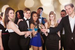 Happy friends toasting drinks at nightclub Stock Images
