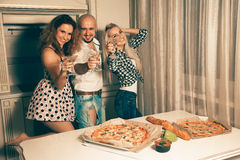 Happy friends toasting at house party Stock Photography