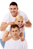 Happy friends together- one woman and two men. Happy friends together- one women and two men Royalty Free Stock Photography