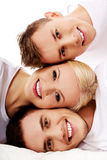 Happy friends together- one woman and two men. Happy friends together- one women and two men Royalty Free Stock Images
