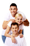 Happy friends together- one woman and two men Royalty Free Stock Image