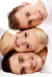 Happy friends together- one woman and two men. Happy friends together- one women and two men Royalty Free Stock Image