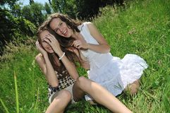 Happy friends together outside. Two happy teen friends (girls) enjoying together outdoors in nature Stock Photo