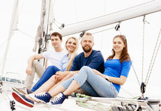 Happy friends traveling on a yacht Royalty Free Stock Images