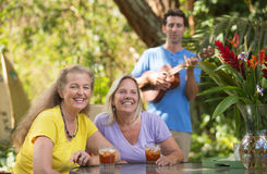 Happy Friends with Ukelele Player Royalty Free Stock Photos