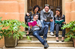 Happy Friends during a University Break. Frontal view of happy friends having fun during a university break Royalty Free Stock Image