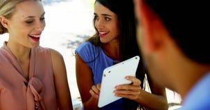 Happy friends using digital tablet stock video footage