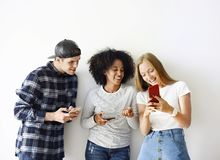 Happy friends using smartphone together. Social media concept stock photography