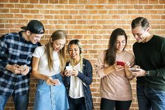 Happy friends using smartphones social media concept royalty free stock photos
