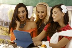Happy girls looking at photos on tablet Royalty Free Stock Photos