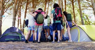 Friends walking towards the tent in park 4k. Happy friends walking towards the tent in park on a sunny day 4k stock footage