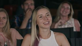 Happy friends watching comedy movie in theater. Close up. Professional shot in 4K resolution. 107. You can use it e.g. in your commercial video, business stock footage