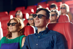Happy friends watching movie in 3d theater Royalty Free Stock Photos
