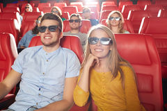 Happy friends watching movie in 3d theater Royalty Free Stock Photography
