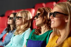 Happy friends watching movie in 3d theater Stock Image