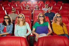 Happy friends watching movie in 3d theater Royalty Free Stock Image