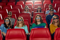 Happy friends watching movie in 3d theater Stock Photos