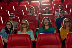 Happy friends watching movie in 3d theater Royalty Free Stock Images