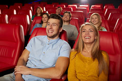 Happy friends watching movie in theater Royalty Free Stock Photography
