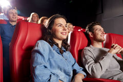 Happy friends watching movie in theater Stock Image