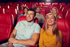 Happy friends watching movie in theater Stock Photos