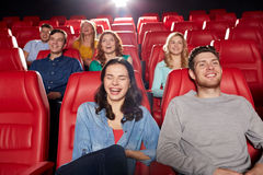 Happy friends watching movie in theater Royalty Free Stock Photos
