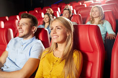 Happy friends watching movie in theater Royalty Free Stock Images