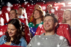 Happy friends watching movie in theater Stock Photography