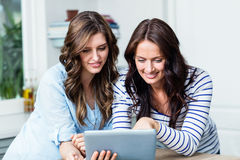 Happy friends watching video on digital tablet Stock Image