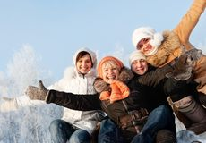 Happy friends on a winter background Royalty Free Stock Image