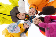 Happy friends in winter clothes outdoors Stock Photos