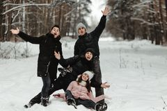 Friends playing with snow in park stock photography
