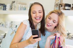 Happy friends women looking at smartphone Stock Photo