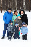Happy friends (two families - seven people) pose in winter day Royalty Free Stock Photo