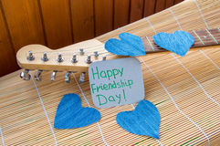 Happy Friendship day 4 Aug. Heart of denim on the guitar.  royalty free stock photography