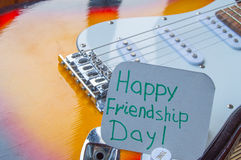 Happy Friendship day 4 Aug. Heart of denim on the guitar.  stock image