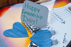 Happy Friendship day 4 Aug. Heart of denim on the guitar.  royalty free stock photos