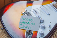 Happy Friendship day 4 Aug. Heart of denim on the guitar.  stock photos
