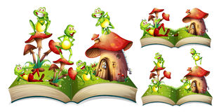 Happy frogs on storybook Royalty Free Stock Photography