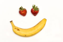 The Happy Fruit. Strawberries and banana forming a happy face Royalty Free Stock Photos