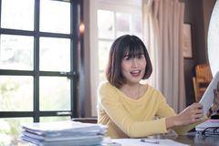 Happy fun asian young business woman working and using tablets Royalty Free Stock Photography
