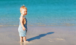 Happy fun   baby on beach near sea in summer Royalty Free Stock Images
