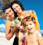Happy fun family with two children at tropical beach. Portrait of  happy fun beautiful family with two children at tropical beach with protective swimming mask Royalty Free Stock Photos