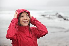 happy fun girl enjoying rain on beach Royalty Free Stock Image
