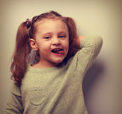 Happy fun kid girl posing in blouse and showing tongue Stock Photos